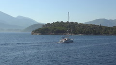 Landscape with Skorpios island seashore seen from a boat trip in a summer day. - stock footage