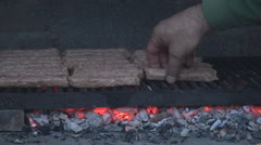 Family weekend lunch, closeup father preparing meat on grill, barbecue flavor  Stock Footage