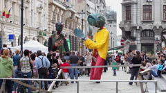 Street Theater Festival,carnival,street show,giant puppets,fantasy,puppet master Stock Footage