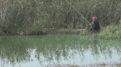 In the middle of lake fisherman arrange bait for fish catch, old school fishing Stock Footage