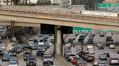 Zoom Out / View of Traffic on Busy Freeway in Downtown Los Angeles Stock Footage