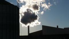 Dark smoke on the factory chimneys with sun beam Stock Footage
