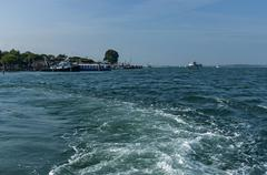 Pontoon and cruise ship anchored in the Venetian lagoon,  Adreatic sea, Italy - stock photo