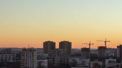 Beauty sundown with blue and orange colors sky, city skyline. Camera moving Stock Footage