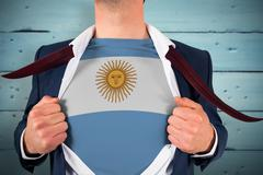 Composite image of businessman opening shirt to reveal argentina flag Stock Photos