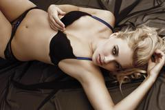 sensual cute woman in lingerie laying down - stock photo