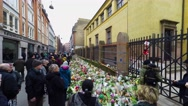 Stock Video Footage of People gather to pay respect for the victims of a terror attack