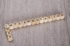 Idea Implementation wooden blocks arranged on table Stock Photos
