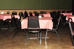 Empty Tables and Chairs At Inexpensive Restaurant Stock Photos