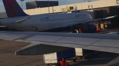 Airplane Jet backing up on tarmac - stock footage