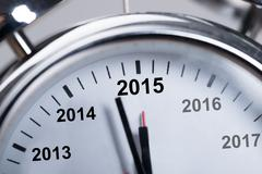 Closeup of happy new year 2015 in alarmclock Stock Photos