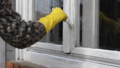 Stock Video Footage of Home renovation, worker painting window