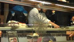 Waitress serving customers at a Cake shop Stock Footage