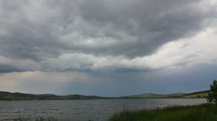 Approaching storm - storm clouds over lake Stock Footage