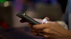 Woman hand texting, sending sms on smartphone in city at night HD - stock footage