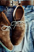 Detail of denim jeans and leather shoes - stock photo