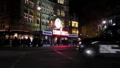 cars passing a theater in London at night - stock footage
