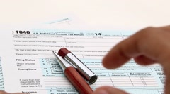 Income tax form and pen. Finance concept  1040 form Stock Footage