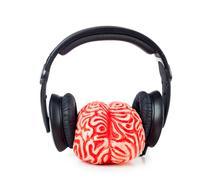Human brain rubber with headphones Stock Photos
