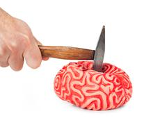 Human brain rubber with hammer blow and blood spill Stock Photos