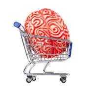 Human rubber brain in the shopping cart - stock photo