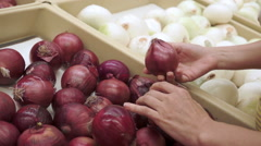 Woman Shopping for Red Onions Handheld Stock Footage