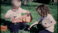 1726 - children play on the grass in the backyard - vintage film home movie Stock Footage