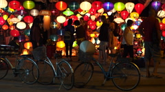 Tourists in Front of Silk Lantern Shop in Old Hoi An, Vietnam Stock Footage
