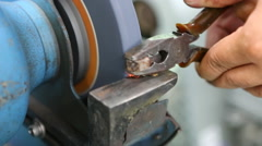 Technician uses grinder to modify nut Stock Footage