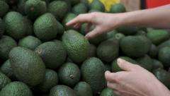 Woman Shopping For Avocados Handheld - stock footage