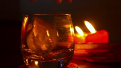 Close up of Pouring Alcohol Drink in a Glass against Burning Candles Stock Footage