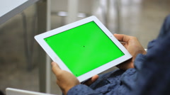 Using Tablet in the book store Stock Footage