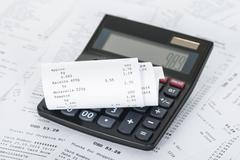 Photo Of Calculator On Generic Receipts With Costs Stock Photos