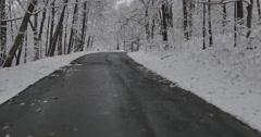 4K, snowfall on upstate road - stock footage