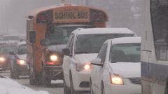 Heavy snow and traffic on record cold winter day in Kitchener Ontario Stock Footage