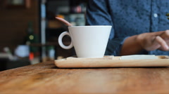 Young man working with tablet pc and drink coffee Stock Footage