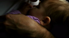 Baby sleeping in the fathers hands, fathers kiss Stock Footage