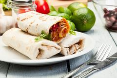 Fresh mexican burritos on a plate Stock Photos