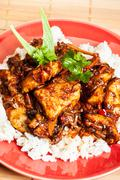 Sweet and sour pork and rice ion plate Stock Photos