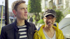 Gay Couple Chat On Their Morning Walk In Sunny San Francisco Neighborhood Stock Footage