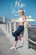 Stock Illustration of Composite image of fit blonde standing on the pier
