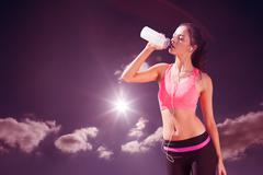 Stock Photo of Composite image of beautiful healthy woman drinking water