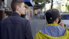 Gay Couple Chat And Drink Coffee On Their Morning Walk In San Francisco Stock Footage