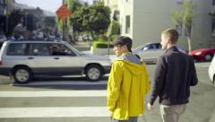 Gay Couple Walk Across Street, With Their Morning Coffee (Slow Motion) Stock Footage