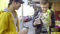 Gay Couple Stop To Smell Flowers Outside Of Flower Shop In San Francisco Stock Footage