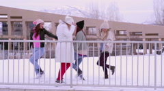 Group Of Friends Dance Around And Kick Snow At Each Other - stock footage