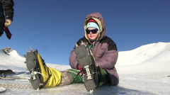 Climber Resting On A Glacier Stock Footage