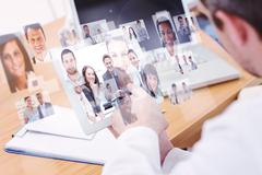 Stock Illustration of Composite image of doctors using laptop and digital tablet in meeting