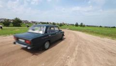 USSR Soviet Сar rides away on the sandy road - stock footage