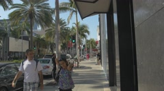 Beautiful palm trees on Rodeo Drive, Beverly Hills Stock Footage